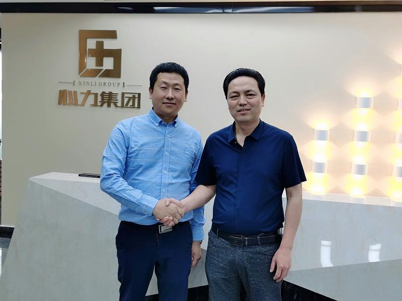 潍坊精翔工贸尹总与心力杨总合影